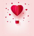 Folded red paper hot air balloon in form of heart