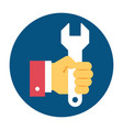 hand holding wrench vector image