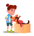 happy little girl takes out of gift box a dog vector image vector image