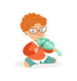 cute redhead little boy playing violin young vector image