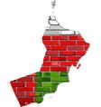 oman map on a brick wall vector image