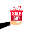 gift box on the hand with a 60 percent discount vector image vector image