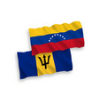 flags venezuela and barbados on a white