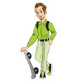 happy man holding a skateboard vector image vector image