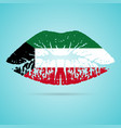Kuwait flag lipstick on the lips isolated on a