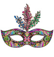 ornate floral Venetian carnival mask with feathers vector image