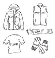 set of hand drawn clothes doodles isolated on a vector image