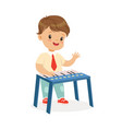 cute little boy playing synthesizer young vector image vector image