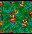 seamless pattern with tiki idols and palm leaves vector image vector image