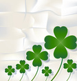 Cloverleaf and shamrock leaf on white paper vector image vector image