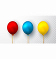 realistic yellow red and blue balloons vector image vector image