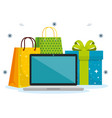 shopping bags with laptop and present to sale vector image vector image
