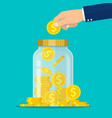 hand throws a gold coin in the jar vector image