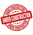 under construction red grunge round vintage rubber vector image vector image