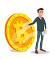 businessman standing with big bitcoin sign vector image