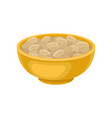 yellow ceramic bowl full of peeled peanuts tasty vector image