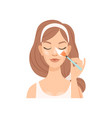attractive young woman cleaning her face with a vector image vector image