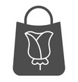 paper shopping bag with rose solid icon flower on vector image vector image