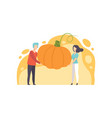 man and woman holding a huge ripe pumpkin vector image vector image
