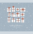 christmas greeting card with gift boxes on blue vector image vector image