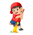 happy boy using the red cap sweep the trash vector image vector image