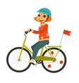 little redhead girl in helmet rides bicycle with vector image vector image