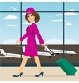 Stewardess walking through airport terminal