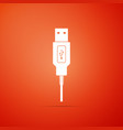 usb cable cord icon isolated on orange background vector image vector image