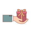 hand holding a gift box in colorful silhouette vector image vector image