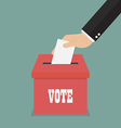 businessman hand putting paper in ballot box vector image