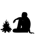silhouette of male tourist sitting near fire vector image