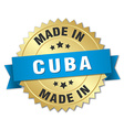 made in Cuba gold badge with blue ribbon vector image vector image