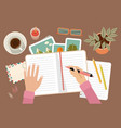 woman s hands holding pen and writing in diary vector image vector image
