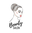Beautiful woman with bun hairstyle beauty salon
