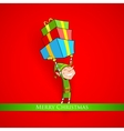 Elf holding Christmas gifts vector image