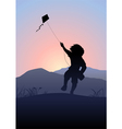 Boy playing a kite vector image vector image