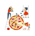 happy family cooking together a pizza vector image vector image