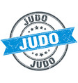 judo round grunge ribbon stamp vector image vector image