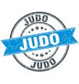 judo round grunge ribbon stamp vector image vector image