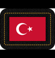 flag of turkey icon on black leather backdrop vector image vector image