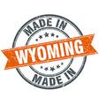 Wyoming orange grunge ribbon stamp on white vector image vector image