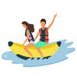man and woman riding on inflatable banana on sea vector image vector image