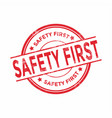 safety first round grunge red stamp vector image vector image