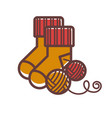 knitted warm socks and balls of woolen threads vector image vector image