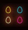 neon color eggs sign isolated on brick wall vector image vector image