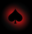 spades symbol on dark background with red light vector image