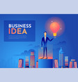 businessman holds up a light bulb on top of the vector image vector image