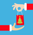 santa claus hand giving taking shopping paper bag vector image vector image