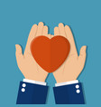 man holds a heart in his hands vector image