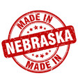made in nebraska red grunge round stamp vector image vector image